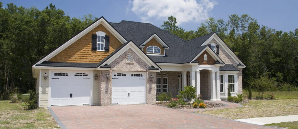 house with paver driveway